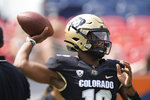 Colorado quarterback Brendon Lewis warms up before the first half of an NCAA college football game against Texas A&M, Saturday, Sept. 11, 2021, in Denver. (AP Photo/David Zalubowski)