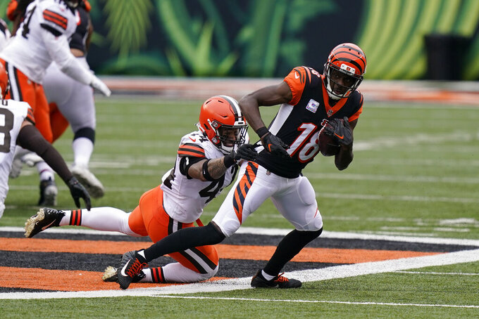Cincinnati Bengals' A.J. Green (18) is tackled by Cleveland Browns' Sione Takitaki (44) during the second half of an NFL football game, Sunday, Oct. 25, 2020, in Cincinnati. (AP Photo/Bryan Woolston)