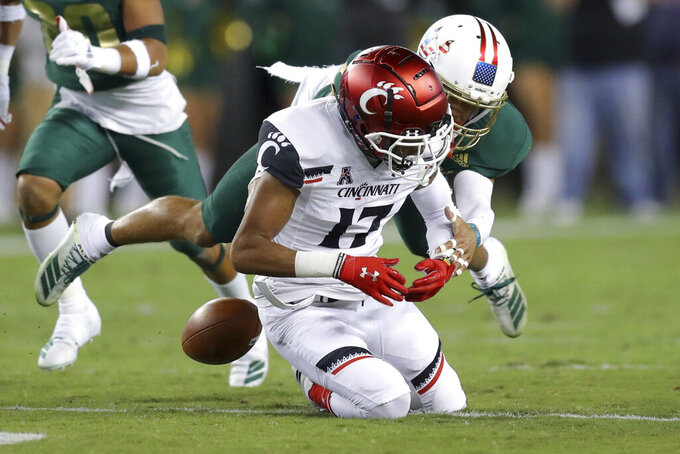 Cincinnati's Rashad Medaris cannot hang on to a pass during the first half of an NCAA college football game against South Florida, Saturday, Nov. 16, 2019, in Tampa, Fla. (AP Photo/Mike Carlson)