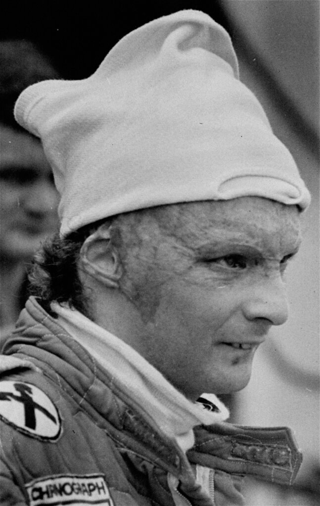 FILE - In this Friday, January 23, 1977 file photo Austria's Niki Lauda, driving for Ferrari during a pit stop at the Grand Prix of Brazil. Three-time Formula One world champion Niki Lauda, who won two of his titles after a horrific crash that left him with serious burns and went on to become a prominent figure in the aviation industry, has died. He was 70. (AP Photo, File)