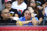 Lulu Cordero mourns as memorial videos are shown of the victims of the Aug. 3 mass shooting during a memorial service, Wednesday, Aug. 14, 2019, at Southwest University Park, in El Paso, Texas. (AP Photo/Jorge Salgado)