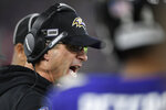 Baltimore Ravens head coach John Harbaugh speaks to players on ther sidelines during the first half an NFL divisional playoff football game against the Tennessee Titans, Saturday, Jan. 11, 2020, in Baltimore. (AP Photo/Nick Wass)