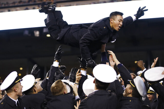 Navy midshipmen celebrate a Navy touchdown during the second half of an NCAA college football game, Saturday, Dec. 14, 2019, in Philadelphia. Navy won 31-7. (AP Photo/Matt Rourke)