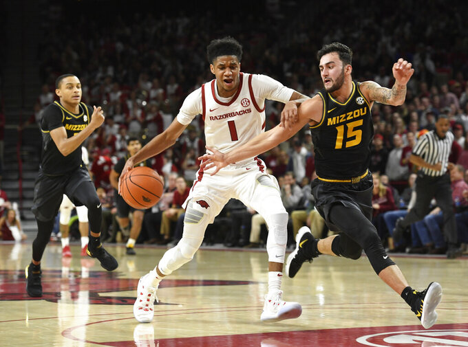 FILE - In this Jan. 23, 2019, file photo, Arkansas guard Isaiah Joe tries to drive to the basket past Missouri guard Jordan Geist during the first half of an NCAA college basketball game Wednesday, Jan. 23, 2019 in Fayetteville, Ark. Joe, one of four starters back from last season, is one of the nation's top 3-pointer shooters. (AP Photo/Michael Woods, File)