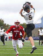 Appalachian State wide receiver Thomas Hennigan (5) hauls in a touchdown pass ahead of South Alabama cornerback Jalen Thompson (1) during the first half of an NCAA college football game Saturday, Oct. 26, 2019, at Ladd-Peebles Stadium in Mobile, Ala. (AP Photo/Julie Bennett)