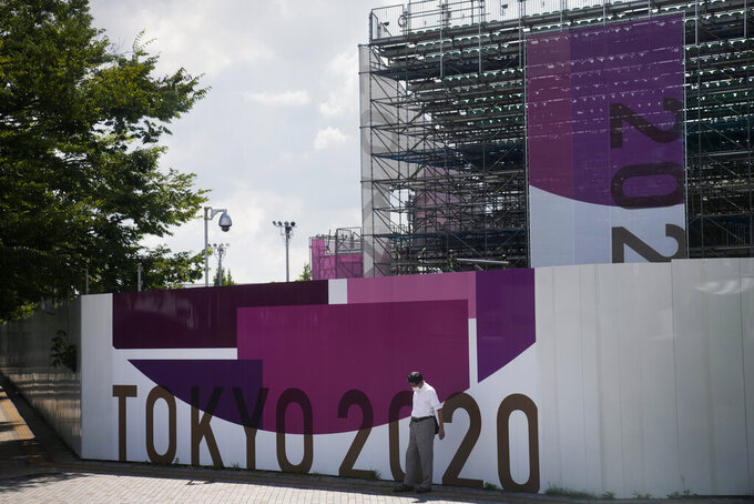 A man stands outside a venue for 3x3 basketball ahead of the 2020 Summer Olympics, Thursday, July 15, 2021, in Tokyo. The pandemic-delayed games open on July 23 without spectators at most venues. (AP Photo/Jae C. Hong)