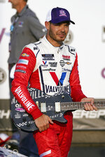 Kyle Larson holds the winner's guitar after winning a NASCAR Cup Series auto race at Nashville Superspeedway Sunday, June 20, 2021, in Lebanon, Tenn. (AP Photo/Mark Humphrey)