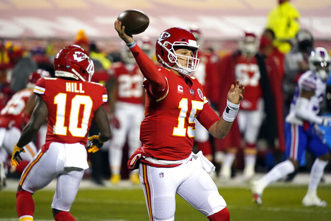 Kansas City Chiefs quarterback Patrick Mahomes throws a pass during the first half of the AFC championship NFL football game against the Buffalo Bills, Sunday, Jan. 24, 2021, in Kansas City, Mo. (AP Photo/Jeff Roberson)