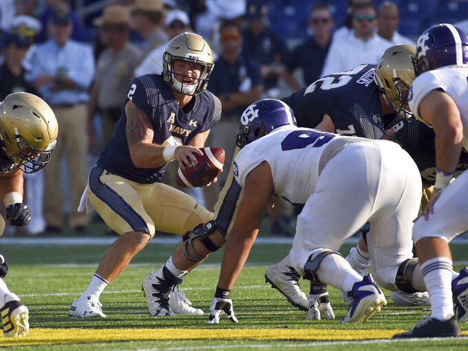 Navy's Tyger Goslin takes the snap against Holy Cross in the fourth quarter of an NCAA college football game, Saturday, Aug. 31, 2019, in Annapolis, Md. (Paul W. Gillespie/Capital Gazette via AP)