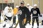 Pittsburgh Penguins goalie Tristan Jarry, center, participates in the team's first NHL hockey practice of the season in Cranberry Township, Pa., Thursday, Sept. 23, 2021. (AP Photo/Gene J. Puskar)