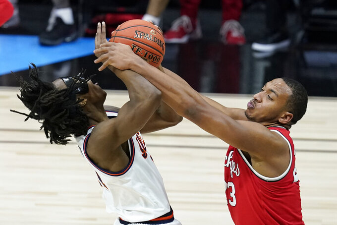 Illinois's Ayo Dosunmu (11) is tied up by Ohio State's Zed Key (23) during the first half of an NCAA college basketball championship game at the Big Ten Conference tournament, Sunday, March 14, 2021, in Indianapolis. (AP Photo/Darron Cummings)