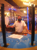 In this June 24, 2020 photo, Joe Lupo, president of the Hard Rock casino in Atlantic City N.J. examines the installation of protective barriers being installed at a card table on the casino floor. Smoking, drinking and eating will all be prohibited when Atlantic City's casinos reopen after being shut for three months due to the coronavirus outbreak under rules imposed by New Jersey Gov. Phil Murphy on June 29, 2020. (AP Photo/Wayne Parry)