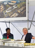 Mellody Hobson, Co-Founder, Lucas Museum of Narrative Art looks at an architectural model of the museum with Angelo Garcia, president of Lucas Real Estate Holdings and vice president of the museum, right, before breaking ground in Los Angeles Wednesday, March 14, 2018. The institution, scheduled to open in 2021, is envisioned as not just a repository for George Lucas'