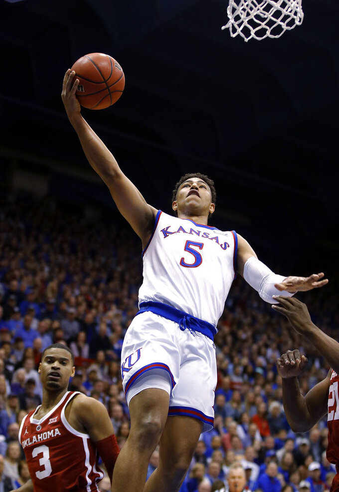 Kansas' Quentin Grimes goes to the basket during the first half of the team's NCAA college basketball game against Oklahoma on Wednesday, Jan. 2, 2019, in Lawrence, Kan. (AP Photo/Charlie Riedel)