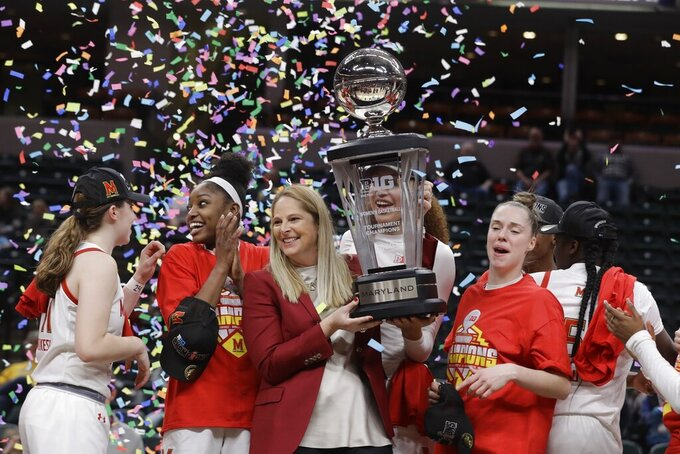 FILE - Maryland head coach Brenda Frese celebrates with her team after they defeated Ohio State to win the NCAA college basketball championship game at the Big Ten Conference tournament in Indianapolis, in this Sunday, March 8, 2020, file photo.Maryland coach Brenda Frese was honored as The Associated Press women's basketball coach of the year Wednesday, March 31, 2021, for the second time in her career.  (AP Photo/Darron Cummings, File)