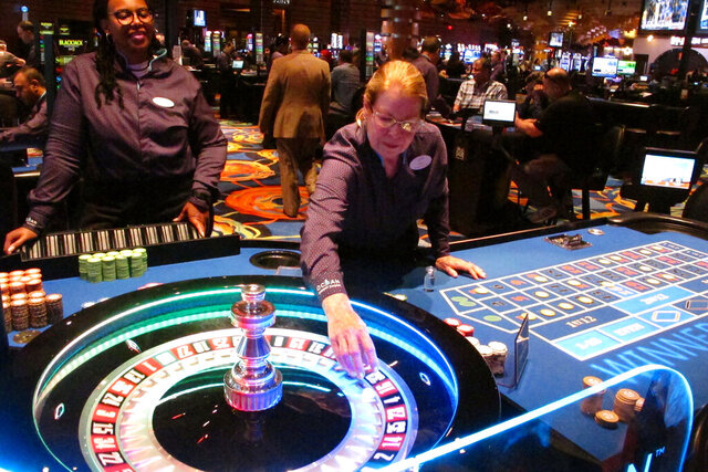 Dealers carry out a game of roulette at the Ocean Casino Resort in Atlantic City N.J. on June 18, 2019.  In a lawsuit filed Thursday, Aug. 27, 2020, Atlantic City's top casino, the Borgata, accuses Ocean Casino Resort of poaching its top marketing executives, including one with a cell phone containing priceless information on the Borgata's top customers, who spend $1.5 million to $4 million per visit. (AP Photo/Wayne Parry)