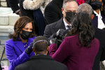 Vice President-elect Kamala Harris and her husband Doug Emhoff greet former President Barack Obama and former first lady Michelle Obama during the 59th Presidential Inauguration at the U.S. Capitol in Washington, Wednesday, Jan. 20, 2021. (AP Photo/Andrew Harnik)
