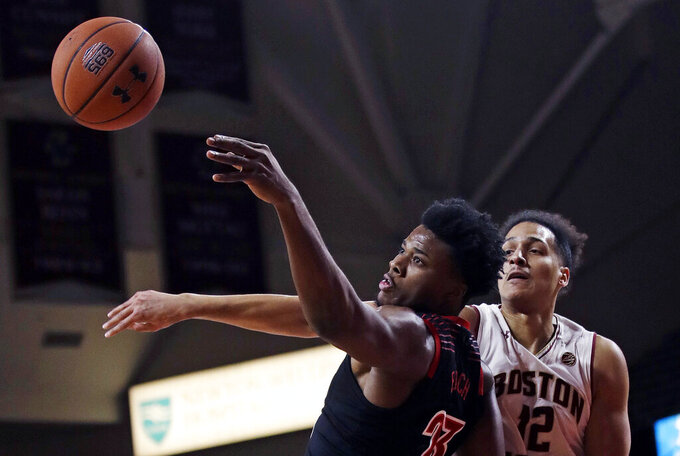 Louisville center Steven Enoch, left, and Boston College center Johncarlos Reyes, right, battle for a rebound during the first half of an NCAA college basketball game in Boston, Wednesday, Feb. 27, 2019. (AP Photo/Charles Krupa)