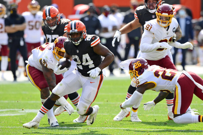 Cleveland Browns running back Nick Chubb (24) rushes for a 16-yard touchdown during the first half of an NFL football game against the Washington Football Team, Sunday, Sept. 27, 2020, in Cleveland. (AP Photo/David Richard)