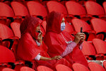 Fans watch the Kansas City Chiefs during NFL football training camp, Saturday, Aug. 29, 2020, at Arrowhead Stadium in Kansas City, Mo. The Chiefs opened the stadium to 5,000 season ticket holders to watch practice as the team plans to open the regular season with a reduced capacity of approximately 22 percent of normal attendance. (AP Photo/Charlie Riedel)