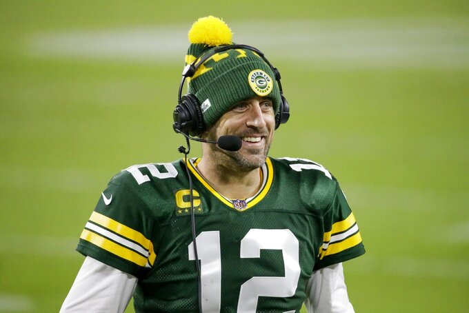 Green Bay Packers' Aaron Rodgers smiles as he is interviewed after an NFL football game against the Philadelphia Eagles Sunday, Dec. 6, 2020, in Green Bay, Wis. The Packers won 30-16. (AP Photo/Mike Roemer)