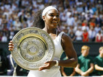 FILE - In this July 11, 2015, file photo, Serena Williams of the United States holds up the trophy after winning the women's singles final against Garbine Muguruza of Spain, at the All England Lawn Tennis Championships in Wimbledon, London. Williams won 6-4, 6-4. (AP Photo/Kirsty Wigglesworth, File)
