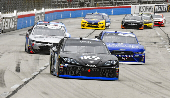 Kyle Busch leads the field on the front stretch during a NASCAR auto race at Texas Motor Speedway, Saturday, March 30, 2019, in Fort Worth, Texas. Busch would win the race. (AP Photo/Larry Papke)