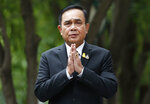 Thailand's Prime Minister Prayuth Chan-ocha gives the traditional greeting, or