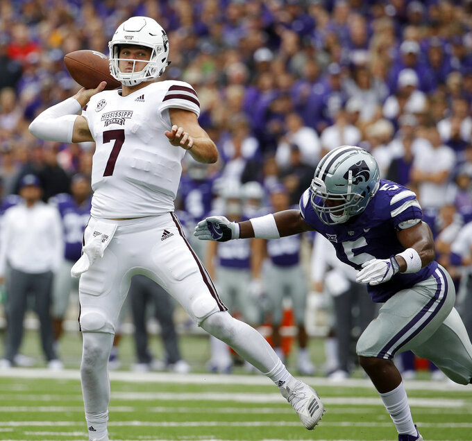 Mississippi State quarterback Nick Fitzgerald (7) passes under pressure from Kansas State linebacker Da'Quan Patton (5) during the first half of an NCAA college football game Saturday, Sept. 8, 2018, in Manhattan, Kan. (AP Photo/Charlie Riedel)