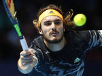 Stefanos Tsitsipas of Greece plays a return to Spain's Rafael Nadal during their ATP World Tours Finals singles tennis match at the O2 Arena in London, Friday, Nov. 15, 2019. (AP Photo/Alastair Grant)