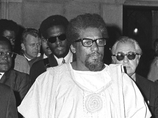 FILE - In this May 11, 1969 file photo, civil activist James Forman walks in New York's Riverside Church. Fifty years ago, Forman interrupted the Sunday worship service and demanded $500 million in reparations for the mistreatment of African Americans from white churches and synagogues. The demands never caught fire in the broader American religious community. But five decades later, the reparations debate has reentered the national spotlight, with some faith-based institutions leading the way. (AP Photo, File)