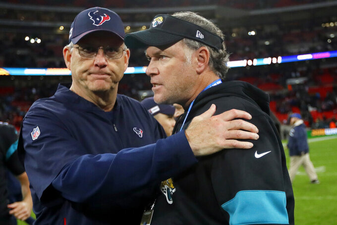 Houston Texans head coach Bill O'Brien, ledft, and Jacksonville Jaguars head coach Doug Marrone speak after an NFL football game at Wembley Stadium, Sunday, Nov. 3, 2019, in London. The Houston Texans won 26-3. (AP Photo/Kirsty Wigglesworth)