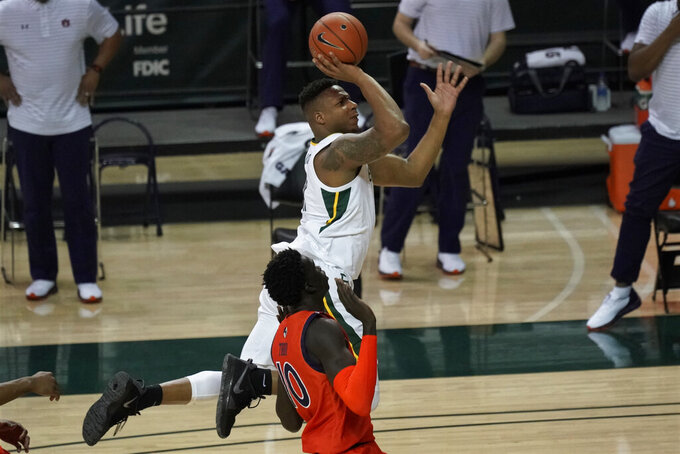 Baylor's Mark Vital, right, shoots against Auburn's JT Thor, left, during the first half of an NCAA college basketball game in Waco, Texas, Saturday, Jan. 30, 2021. (AP Photo/Chuck Burton)
