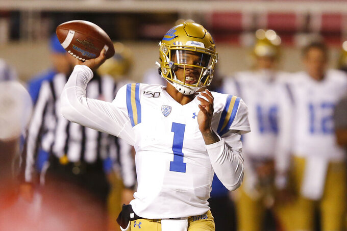 UCLA quarterback Dorian Thompson-Robinson (1) passes the ball against Utah in the first half during an NCAA college football game Saturday, Nov. 16, 2019, in Salt Lake City. (AP Photo/Rick Bowmer)