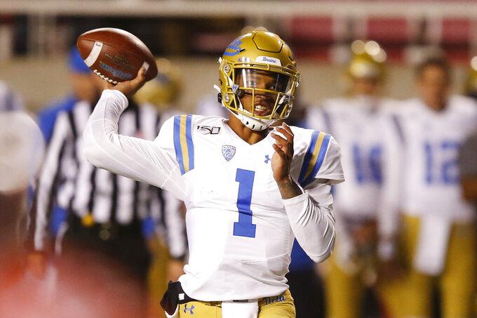 UCLA quarterback Dorian Thompson-Robinson (1) passes the ball against Utah in the first half during an NCAA college football game Saturday, Nov. 16, 2019, in Salt Lake City. (AP Photo/Rick Bowmer)