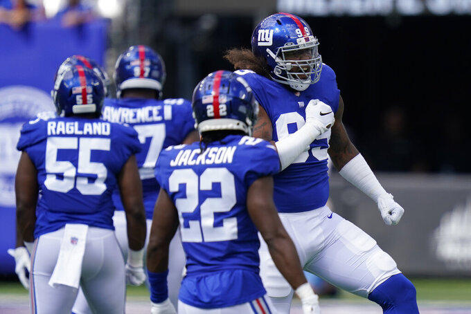 New York Giants defensive end Leonard Williams (99) reacts after making a tackle on Atlanta Falcons running back Cordarrelle Patterson during the first half of an NFL football game, Sunday, Sept. 26, 2021, in East Rutherford, N.J. (AP Photo/Seth Wenig)