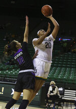 Baylor center Hannah Gusters, right, shoots over Central Arkansas guard Carley Hudspeth during the first half of an NCAA college basketball game Wednesday, Nov. 25, 2020, in Waco, Texas. (Rod Aydelotte/Waco Tribune Herald via AP)