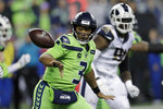 Seattle Seahawks quarterback Russell Wilson (3) pitches out to tight end Will Dissly during the second half of the team's NFL football game against the Los Angeles Rams on Thursday, Oct. 3, 2019, in Seattle. (AP Photo/Stephen Brashear)