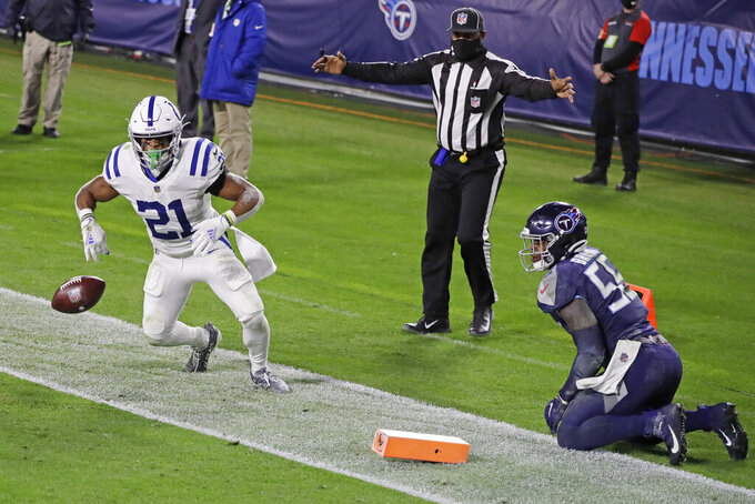 Indianapolis Colts running back Nyheim Hines (21) scores a touchdown against Tennessee Titans inside linebacker Jayon Brown (55) in the first half of an NFL football game Thursday, Nov. 12, 2020, in Nashville, Tenn. (AP Photo/Ben Margot)