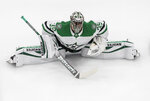 Dallas Stars goalie Anton Khudobin (35) stretches during a warm-up before an NHL Western Conference Stanley Cup playoff game against the Dallas Stars, in Edmonton, Alberta, on Monday, Aug. 24, 2020. (Jason Franson/The Canadian Press via AP)