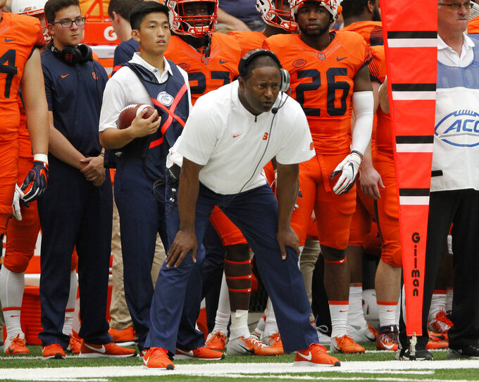 Syracuse head coach Dino Babers watches in the first quarter of an NCAA college football game against Florida State in Syracuse, N.Y., Saturday, Sept. 15, 2018. (AP Photo/Nick Lisi)