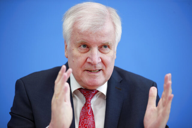 Horst Seehofer (CSU), Federal Minister of the Interior, Homeland and Construction, presents the 2019 Report on the Protection of the Constitution at the Federal Press Conference in Berlin, Germany, Thursday, July 9 2020. (Hannibal Hanschke/Pool via AP)