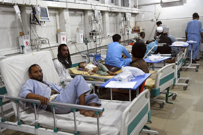Wounded Afghans lie on a bed at a hospital after a bomb attacks in the city of Jalalabad east of Kabul, Afghanistan, Saturday, Sept. 28, 2019. Afghans headed to the polls on Saturday to elect a new president amid high security and Taliban threats to disrupt the elections, with the rebels warning citizens to stay home or risk being hurt. (AP Photo/Mohammad Anwar Danishyar)
