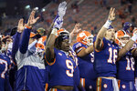 Clemson running back Travis Etienne (9) and quarterback Trevor Lawrence (16) wave after the team's win over Pittsburgh in an NCAA college football game Saturday, Nov28, 2020, in Clemson, S.C. (Ken Ruinard/The Independent-Mail via AP, Pool)