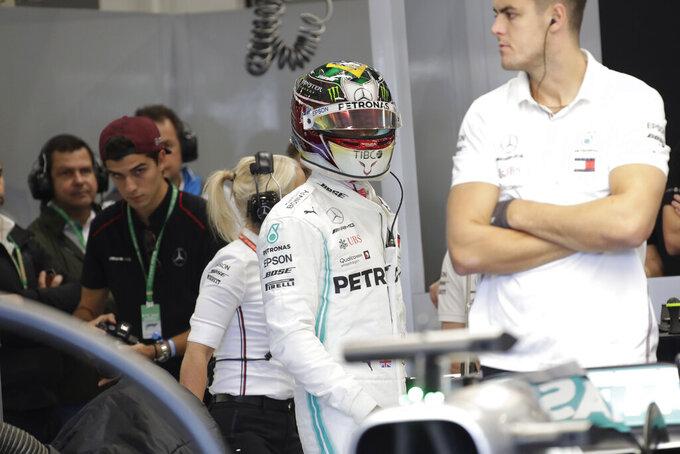 Mercedes driver Lewis Hamilton, of Britain,, center, prepares for the third free practice session for the Formula One Brazil Grand Prix auto race at the Interlagos race track in Sao Paulo, Brazil, Saturday, Nov. 16, 2019. (AP Photo/Silvia Izquierdo)