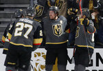 Vegas Golden Knights right wing Mark Stone, second from right, celebrates with teammates after scoring against the Toronto Maple Leafs during the third period of an NHL hockey game Tuesday, Nov. 19, 2019, in Las Vegas. (AP Photo/John Locher)