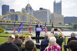 Pennsylvania's Democratic attorney general Josh Shapiro speaks to a crowd with the city skyline behind him during his campaign launch address for Pennsylvania governor, Wednesday, Oct. 13, 2021, in Pittsburgh. (AP Photo/Keith Srakocic)