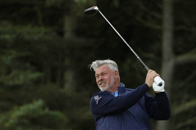 FILE - In this July 18, 2019, file photo, Northern Ireland's Darren Clarke hits his tee shot on the fifth hole during the first round of the British Open Golf Championships at Royal Portrush in Northern Ireland. Timing was everything for Darren Clarke. He won for the first time on the PGA Tour Champions in the final week before he had to leave the United States because his visa expired. (AP Photo/Matt Dunham, File)