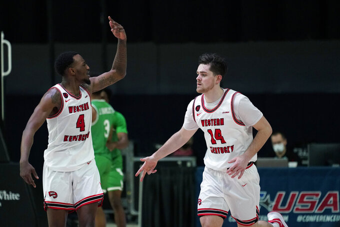 Western Kentucky guard Luke Frampton (14) celebrates with teammate Josh Anderson, left, after making a 3-point basket during the first half of the championship game against North Texas in the NCAA Conference USA men's basketball tournament Saturday, March 13, 2021, in Frisco, Texas. (AP Photo/Tony Gutierrez)