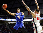 Kentucky guard Keldon Johnson (3) attempts a layup past Mississippi center Dominik Olejniczak (13) during the first half of an NCAA college basketball game in Oxford, Miss., Tuesday, March 5, 2019. (AP Photo/Rogelio V. Solis)